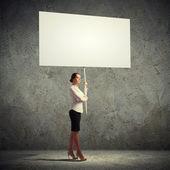 Woman holding blank board — Stock Photo