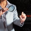 Businesswoman with magnifier glass - Stock Photo