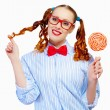 Young woman holding candy — Stock Photo #26302085