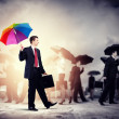 Businessman with umbrella — Stock Photo #26304151