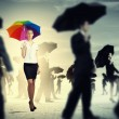 Businesswoman with umbrella — Stock Photo