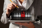 Businesswoman holding tablet pc — Stock Photo