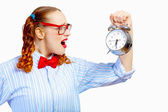 Teenager girl holding alarm clock — Stock Photo