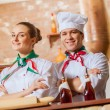 Portrait of two cooks with crossed arms — Stock Photo #26312237