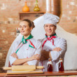 Portrait of two cooks with crossed arms — Stock Photo #26312239