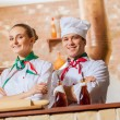 Portrait of two cooks with crossed arms — Stock Photo