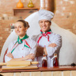 Stock Photo: Portrait of two cooks with crossed arms