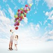 Mother and daughter with balloons — Stock Photo