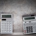 Businesspeople with big calculators — Stock Photo #26314339