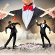 Businessman puppeteer — Stock Photo #26318155