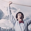 Businessman hanging on rope — Stock Photo