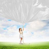 Little girl pulling banner — Stock Photo