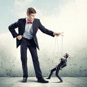Businessman puppeteer — Stock Photo