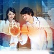 Two doctors examining heart — Stock Photo #26320403