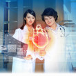 Two doctors examining heart — Stock Photo #26320413