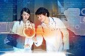 Two doctors examining heart — Stock Photo
