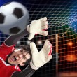 Goalkeeper catches the ball — Stock Photo