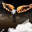 Businessman drawing wings — Stock Photo #26352089