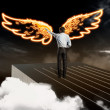 Businessman drawing wings — Stock Photo