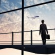 Businessman at airport — Stockfoto