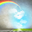 Rainbow in sky - Stock Photo