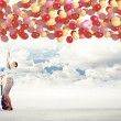 Family holding colorful balloons — Stock Photo