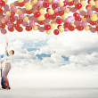 Family holding colorful balloons — Stock Photo #26355713