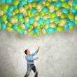 Adult man pulling a rope with balloons — Stock Photo