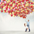 Father and daughter holding balloons — Stock Photo