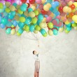 Stock Photo: Young woman holding balloons