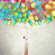 Young woman holding balloons — Stock Photo #26355787