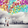 Family holding colorful balloons — Stock Photo #26355801