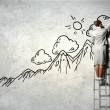 Woman standing on ladder drawing on wall — Stock Photo