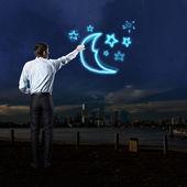 Homme d'affaires dessine une lune et étoiles — Photo