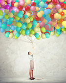 Young woman holding balloons — Stock Photo