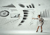 Businesswoman and business diagrams — Stock Photo
