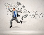 Jumping young businessman — Stock Photo