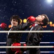 Two young businessman boxing — Stock Photo