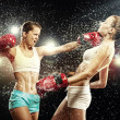 Stock Photo: Two pretty women boxing