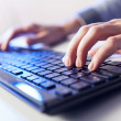 Stock Photo: Click! Hands of a man on keyboard