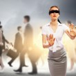 Businesswoman in blindfold among group of — Stock Photo #26411603