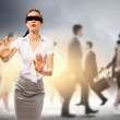 Businesswoman in blindfold among group of — Stock Photo