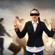 Businesswoman in blindfold among group of — Stock Photo #26411643