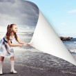 Little girl turning page — Stock Photo