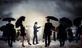 Businessman in blindfold among group of — Foto Stock