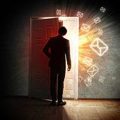 Young businessman opening door — Stock Photo
