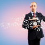 Business man holding alarmclock — Stock Photo #26424247