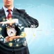 Business man holding alarmclock — Stock Photo