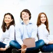 Stock Photo: Three students smiling