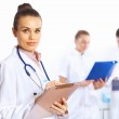 Young female doctor in white uniform — Stock Photo